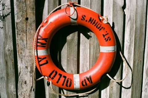 red-life-buoy-on-wooden-fence.jpg