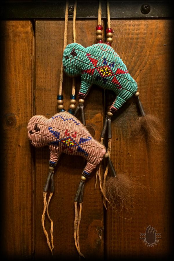 Two Tiny Beaded Buffalo Amulets 1 logo ver